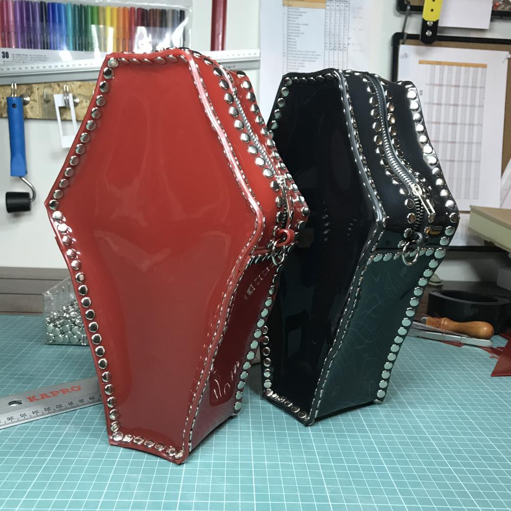 PVC handbags in the shape of coffins