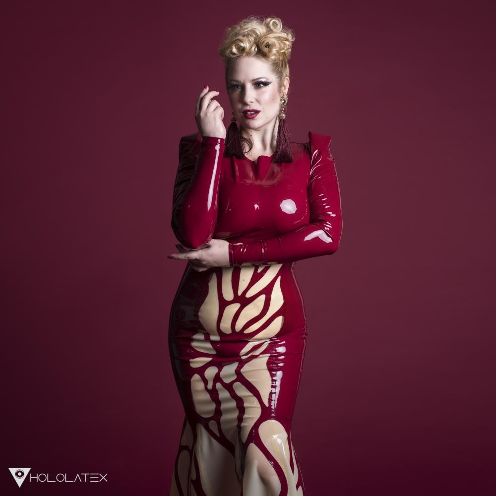 Angelina Angelics in latex dress made of wine latex.