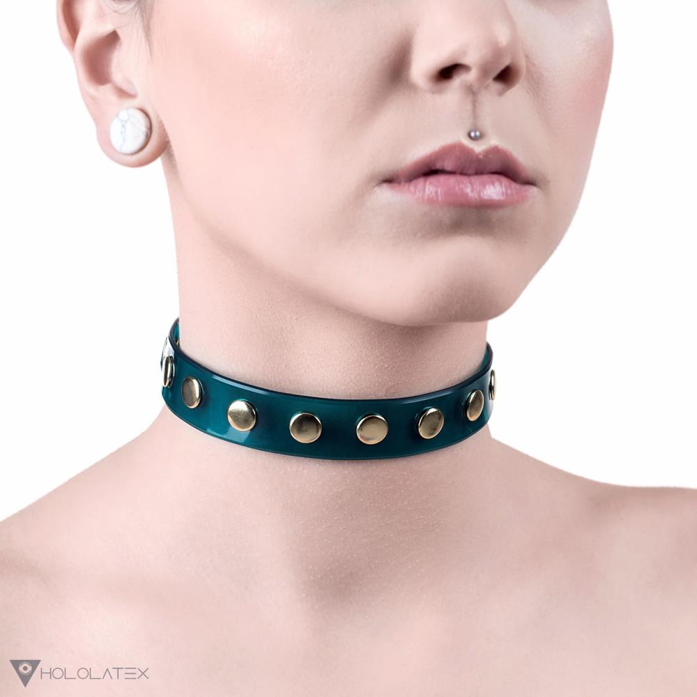 PVC neck choker in transparent green color decorated with rivets in gold color.