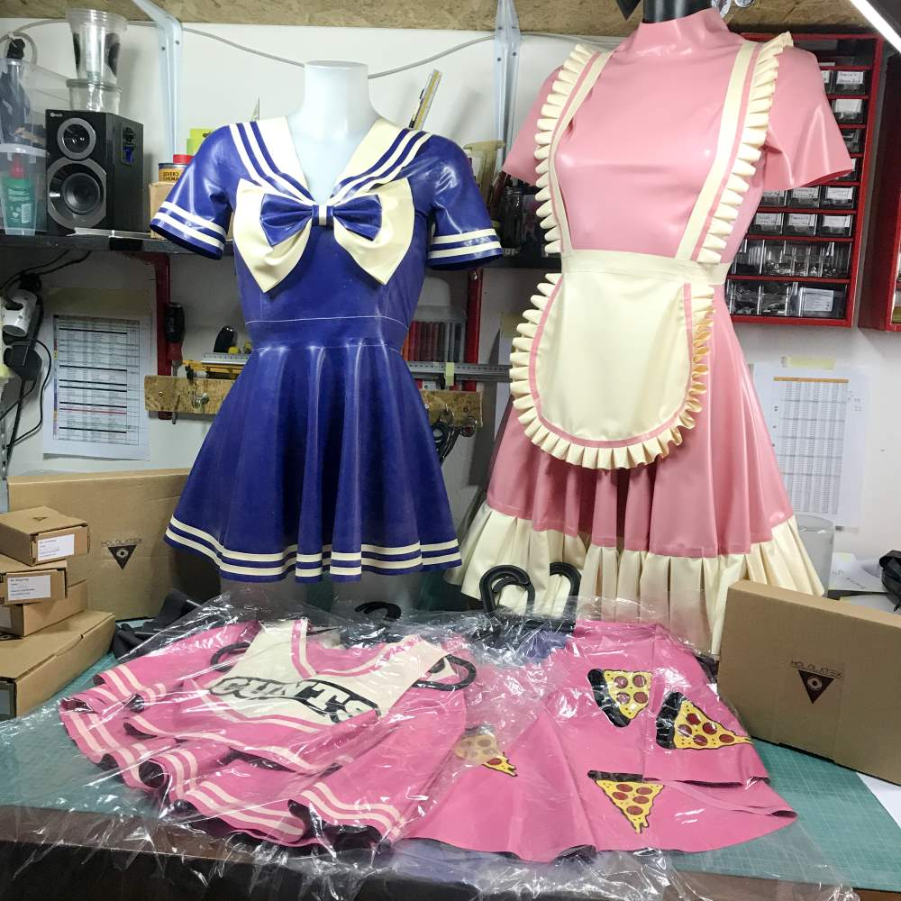 Latex dress and other goods around.