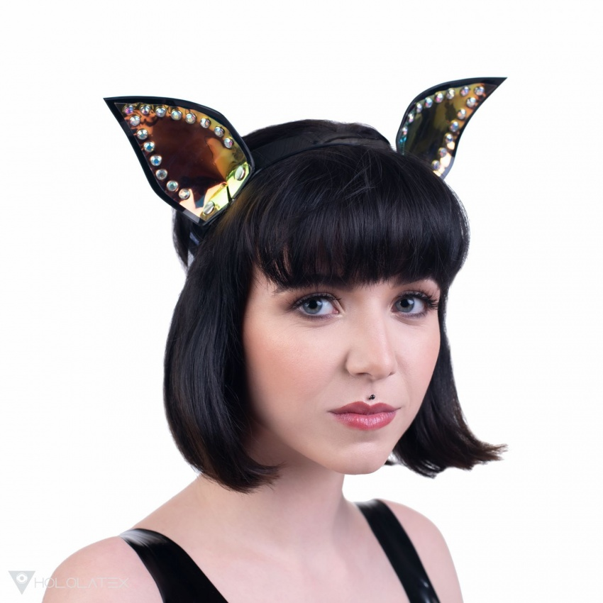 A headband with dog ears with holographic foil and rhinestones.