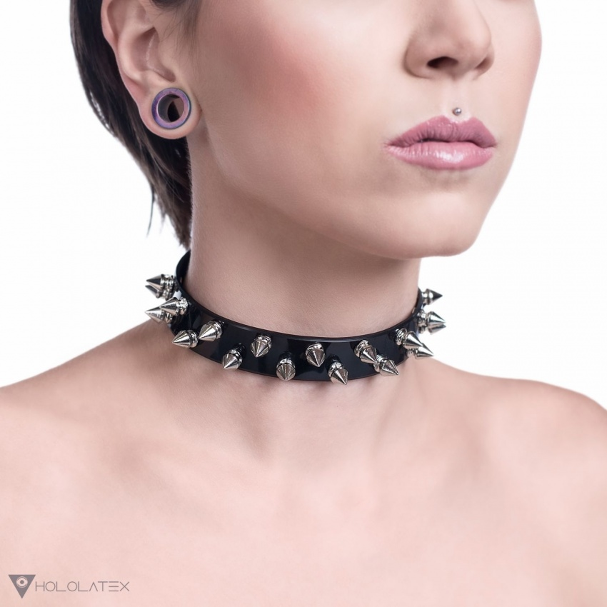A black choker necklace decorated with two rows of short metal spikes in silver.