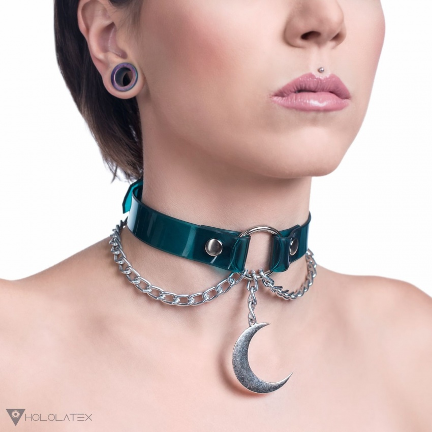 Choker necklace made from transparent green PVC decorated with metal chains and a moon attached to a ring in silver.