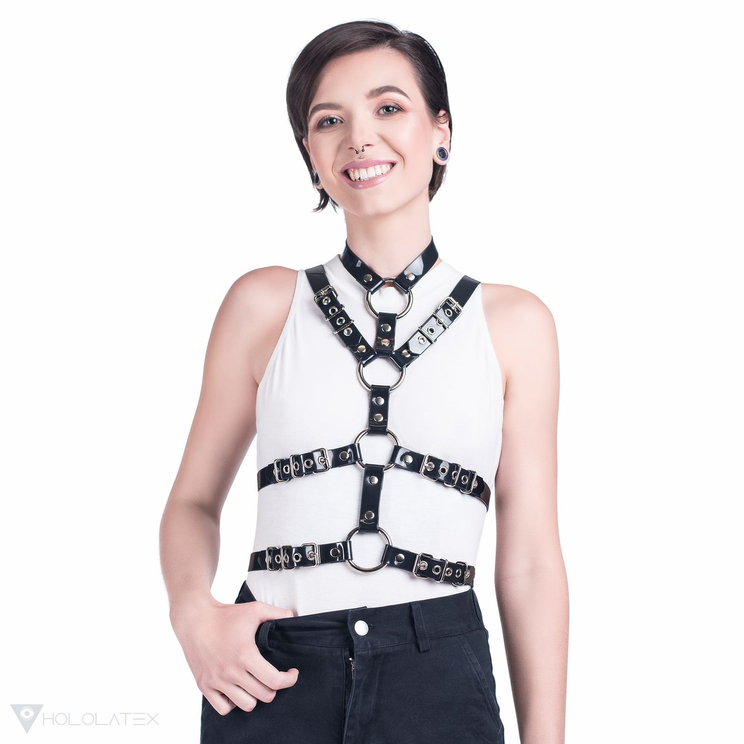 Fashion harness made of 2 cm wide straps over the entire chest in black.