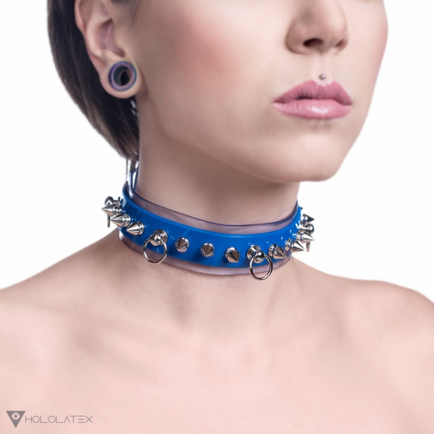 A choker necklace from transparent and blue soft PVC, decorated with spikes and metal elements.
