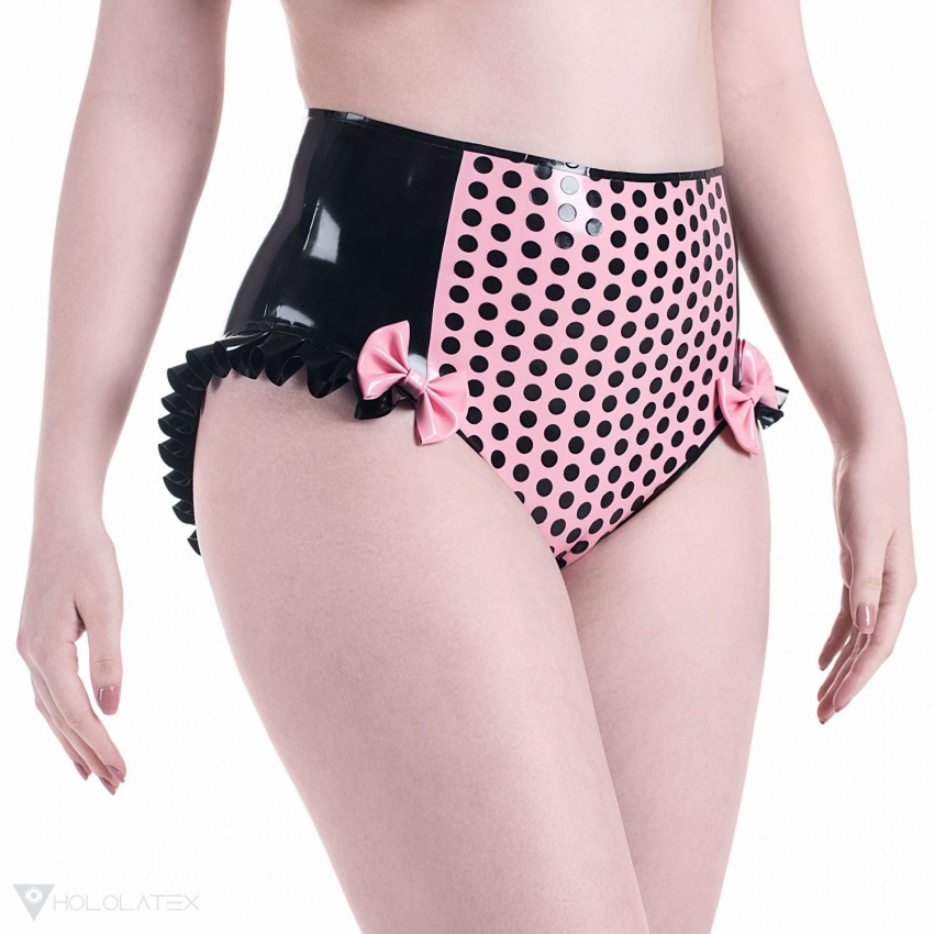 Black high waisted latex panties with contrast pink midlle panel, decorated with polka dots, ruffles and bows.