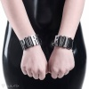 """Black bracelets made from PVC decorated with """"PURE"""" and """"EVIL"""" custom sign with metal letters - detail."""