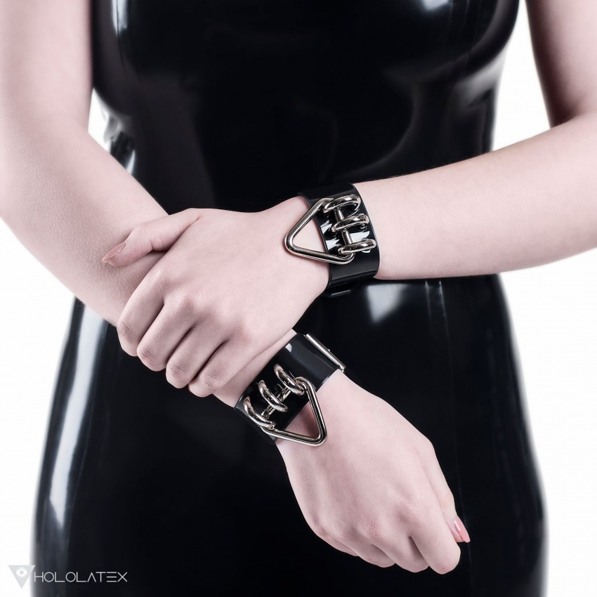 A black bracelet from PVC decorated with small hung up metal triangles.
