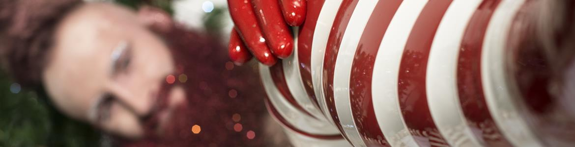 Blog header - Christmas elf in latex stockings and gloves.
