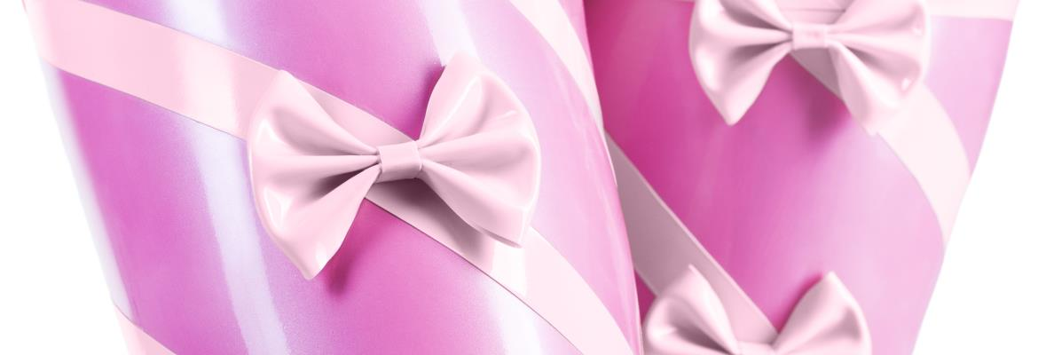 Close-up of pink latex stockings with stripes and bows.