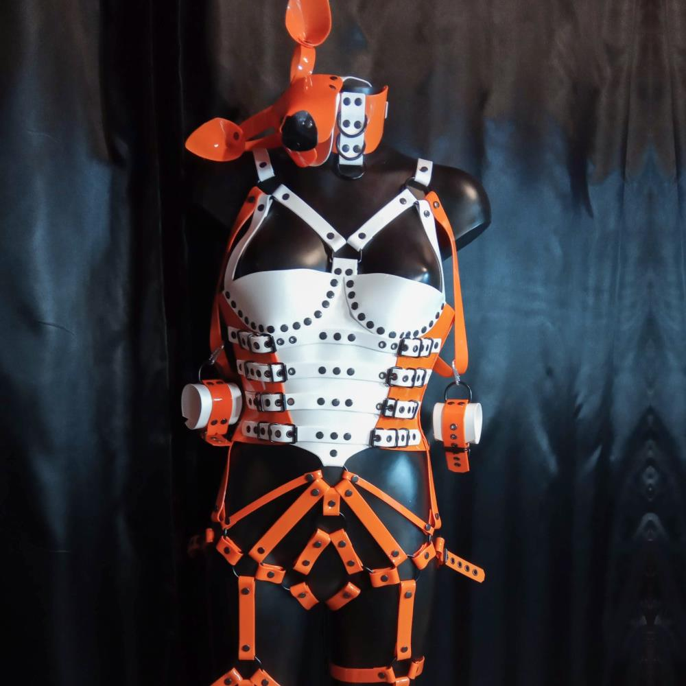 Full body harness with corset made of white and orange PVC and black fittings.