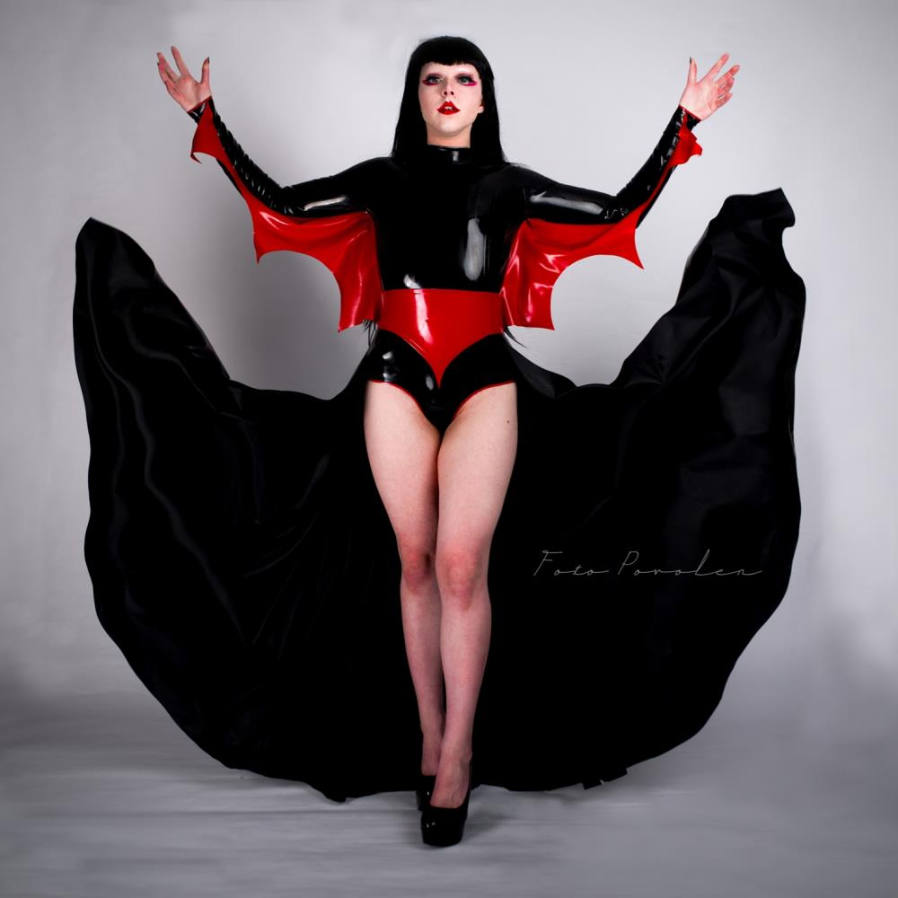 Custom black latex points with a long veil and vampire wings under the arms.